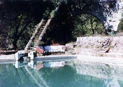 Hacienda Pool  &  Aqueduct in Background With Arches